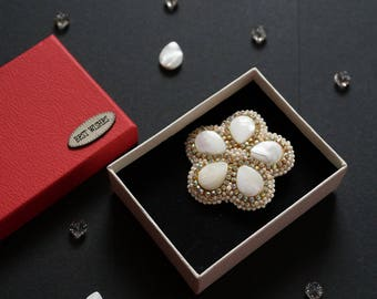 flower brooch white on the chest on the clothes