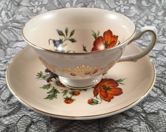 Royal Grafton peach with beautiful flower design and gold edging