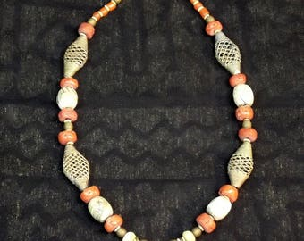 Glass coral trade beads