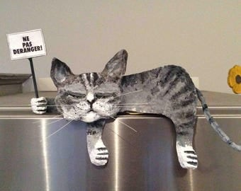 The tired gray cat, paper mache and acrylic.