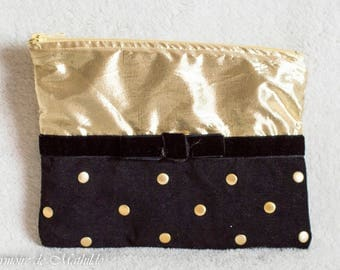 The bow black and gold 21 cm x 15 cm clutch