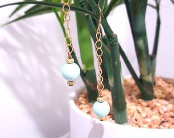 Light blue 10mm bead on gold chain drop earrings