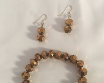 Gold beaded stretch bracelet with matching earrings