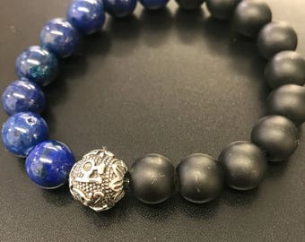Beaded bracelet with obsidian and lapis lazuli with stainless steel Tibetan prayer bead