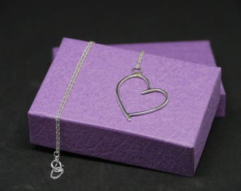Handcrafted sterling silver heart necklace with a sterling silver chain.