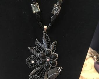 Black and silver flower pendant beaded necklace and earrings
