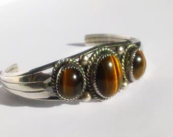 Striking signed TOM AHASTEEN Navajo Sterling Silver Tiger's Eye Cuff bracelet