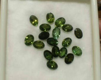 Multi listing: 7mm by 5mm oval facet green tourmaline gemstone