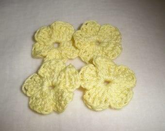 Set of four mini crochet flowers