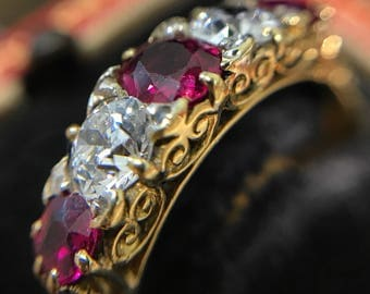 Antique ruby and diamond late Victorian carved half hoop ring
