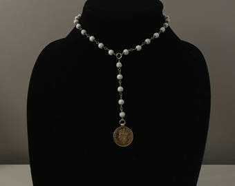 Marble-like beading with coin attatched to dropdown