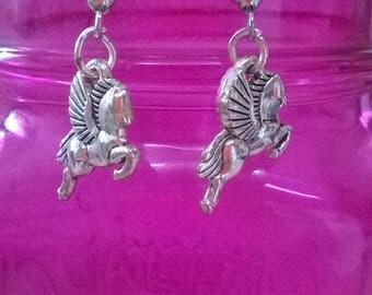 Pegasus earrings.