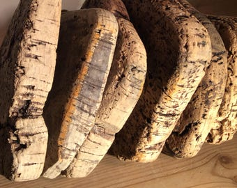 Original fishing float of six square corks on weathered rope