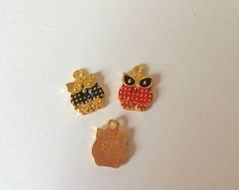 OWL gold and enamel