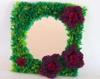 Ornate mirror frame made of wool