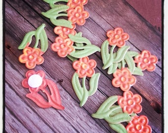 set of 12 orange and green metal flowers