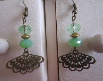Bronze fan earrings and green faceted beads
