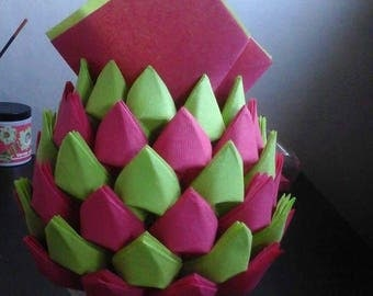 Folding towel in the shape of lime green and pink pineapple dispenser