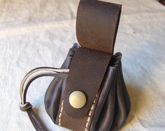 Coin purse is handmade brown leather