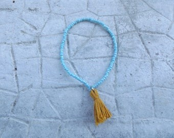 Pearl bracelet blue and yellow Pompom