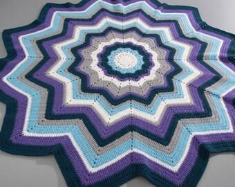 Plaid wool blanket, form star, blue/purple/gray.