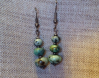 Dangling earrings African turquoise beads.