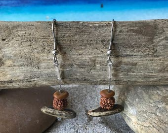 Earrings with natural seeds of the West Indies