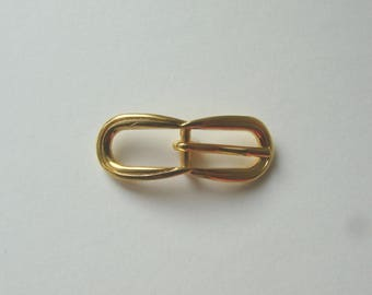 Oval belt buckle, 50 x 19 mm, gold tone.
