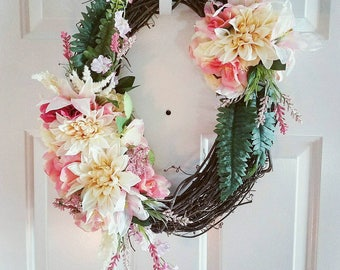 """18"""" oval grapevine wreath with pink flower accents"""