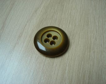 large green round button