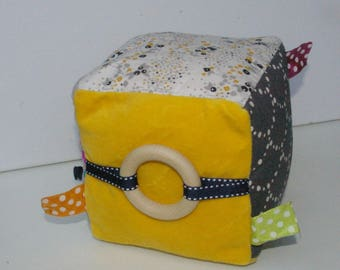 Educational cube fabric with predominantly yellow Montessori inspired Bell
