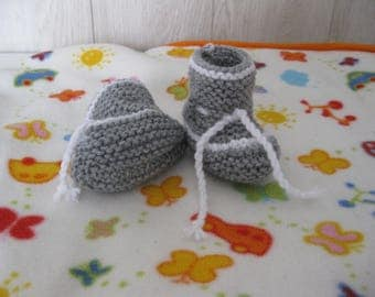 Gray and white baby booties
