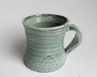 Original Cup, handle leaf shaped decoration of lace, enameled green leaf