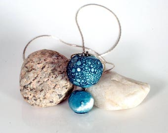 Between land and sea pottery necklace