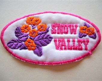 applied Snow Valley embroidered pink flowers and purple on white background, outline rose 9 cm