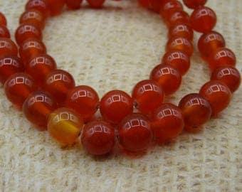 orange 20 8mm round beads agate heated