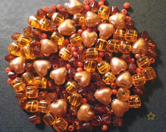 140 synthetic pearls, orange and amber