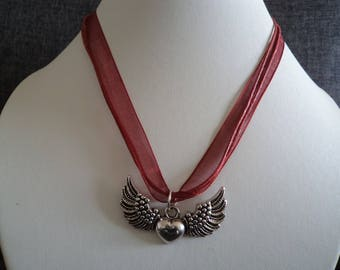 Necklace with winged heart pendant perfect for mother's day