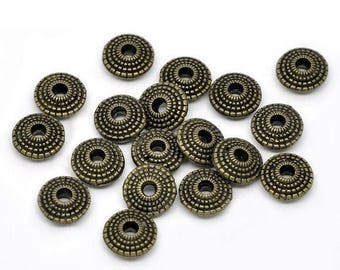 10 spacer beads form flying saucer, striated, bronze
