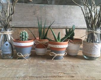 Terracotta clay pots with lace and Twine for cactus