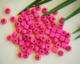 Mix of wooden beads, pink, 60-70 pieces of different shapes