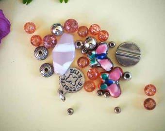 Great bracelet, 30 beads in various materials. resin, glass, ceramic, metal tone pink