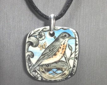 "One of a kind Robin in nest Pendant/Necklace. Hand painted porcelain with 18"" black cord. Signed"