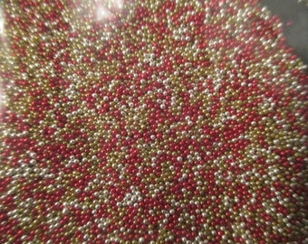 Bag a little more than 20 grams of micro beads red yellow and silver