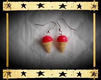 Ice-cream cone with vanilla and bright red ball mounted on silver plated