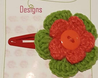 red and green flower hair clip