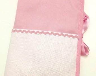 Health book has pink cross-stitch aida choice