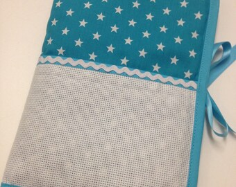 Health book has cross-stitch, white stars turquoise background aida choice
