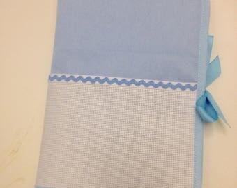 Health book has cross-stitch, sky blue 100% cotton fabric, choose outline