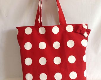 Straps in red canvas beach bag and its polka dots